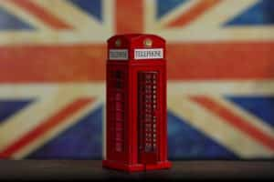 UK phone booth with the United Kingdom flag behind