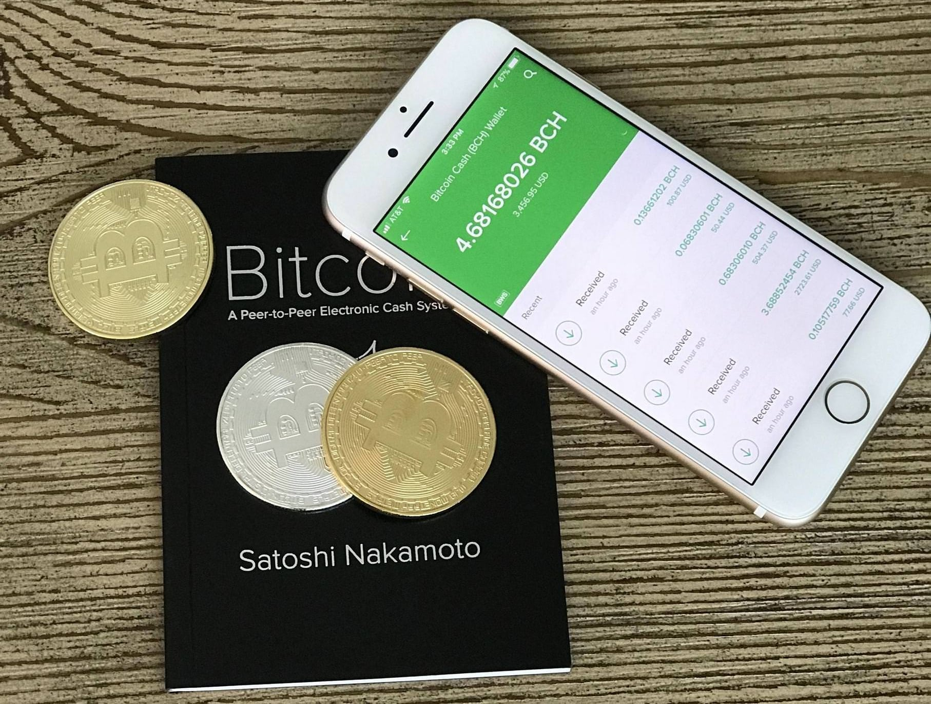 Bitcoin Cash coins and smartphone with an application opened