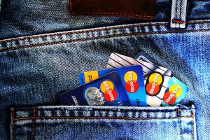 MasterCard cards in a pocket investing in blockchain technology